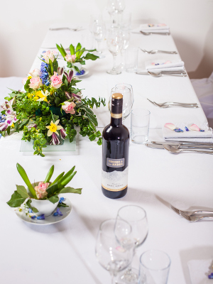 table with bouquet and wine